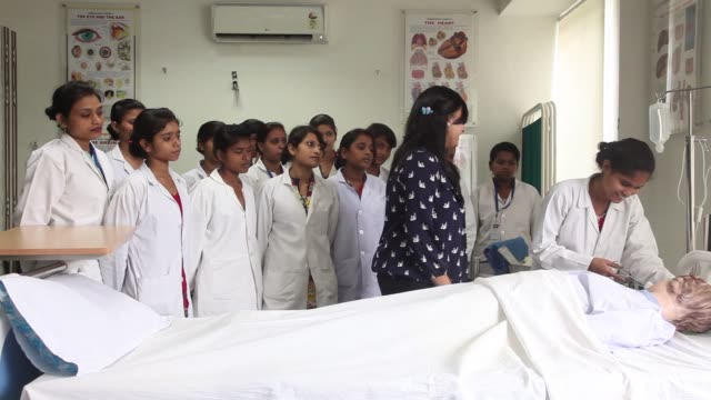 students attend a sewing class during vocational training at the infrastructure leasing financial services institute of skills in new delhi india on... - nursing assistant stock videos and b-roll footage