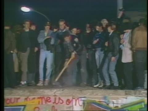students begin to demolish the berlin wall. - breaking stock videos & royalty-free footage