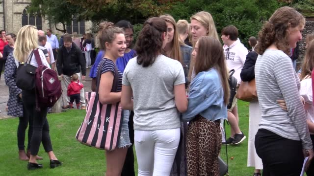 students celebrate after collecting their gcse results at norwich school in norwich norfolk gcse pass rates rose this year in the wake of the biggest... - 一般教育証明試験点の映像素材/bロール