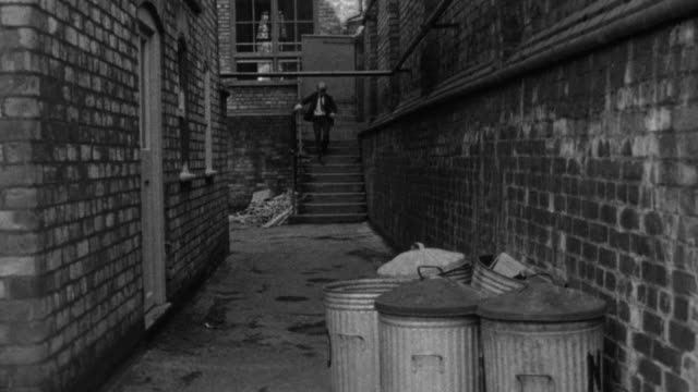 1976 b/w students chase another student home after school / liverpool, merseyside, england - bullying stock videos and b-roll footage