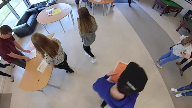 students collecting gcse results at birchwood community high school in warrington after exams were cancelled due to coronavirus pandemic - chaos stock videos & royalty-free footage
