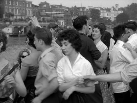 students dance on board a riverboat as it sails along the river thames. - fluss themse stock-videos und b-roll-filmmaterial