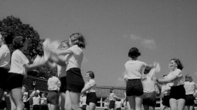 1940 montage students dancing in groups during recess / united kingdom - 1940 stock videos and b-roll footage
