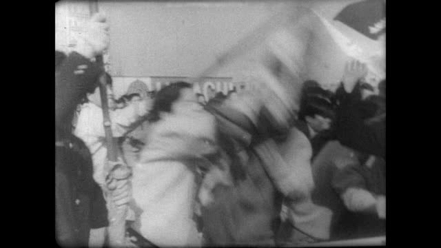students demonstrate by pushing back police forces on the streets of tokyo / students wielding bamboo poles as weapons and police in riot gear /... - 1967 bildbanksvideor och videomaterial från bakom kulisserna