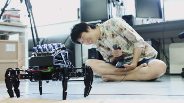 Students Demonstrating Spider-Like Robot