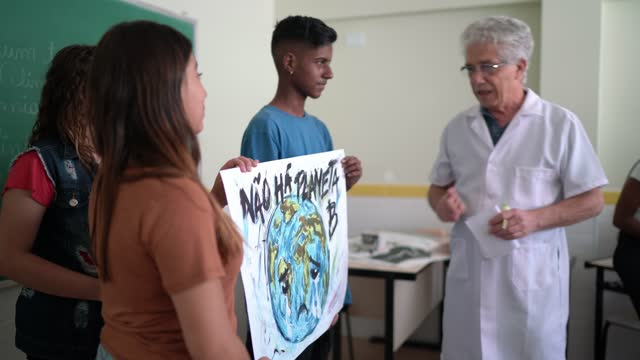 students doing a presentation about environmental issues - there is no planet b (in portuguese) - environmental issues stock videos & royalty-free footage