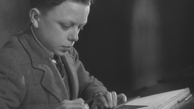 1947 montage students drafting and using carpentry tools / united kingdom - 1947 stock videos & royalty-free footage