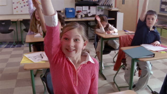 Students eagerly raising hands in class / Gorham, Maine