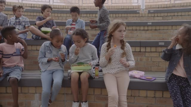 students eating lunch during break at amphitheater - lunch stock videos & royalty-free footage