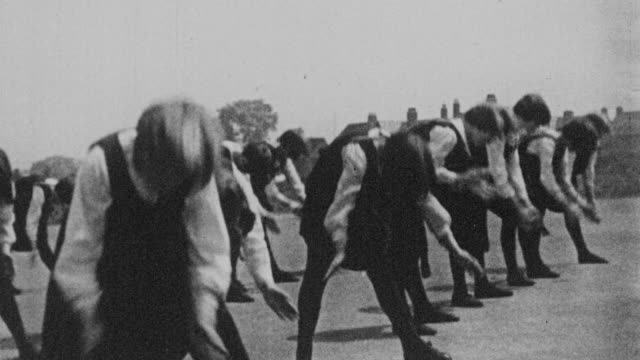 montage students exercising in schoolyard, performing gymnastics in the gym, and learning to swim / united kingdom - 1931 stock videos & royalty-free footage