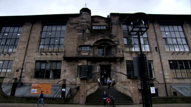 Students exit and enter the Glasgow School of Art building. Available in HD.