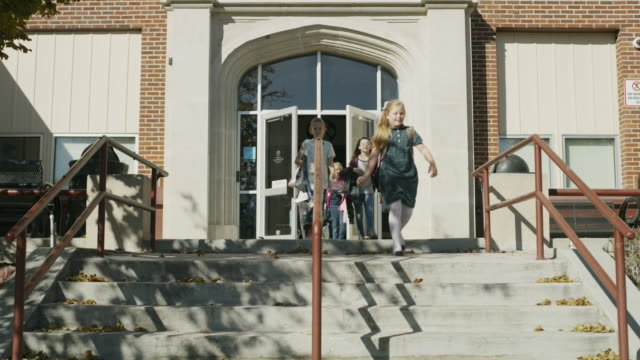 Students exiting school and descending staircase / Provo, Utah, United States