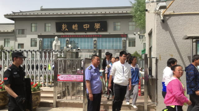 Students finish their exam walking out of Dunhuang high school On June 78 the college entrance examination are held all over the country The number...