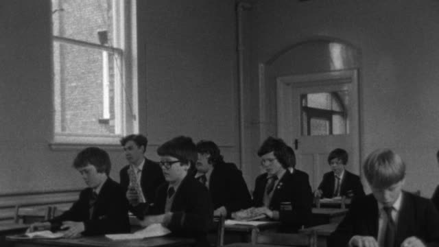 1976 b/w students finishing class and preparing to leave classroom / liverpool, merseyside, england - educational event stock videos & royalty-free footage