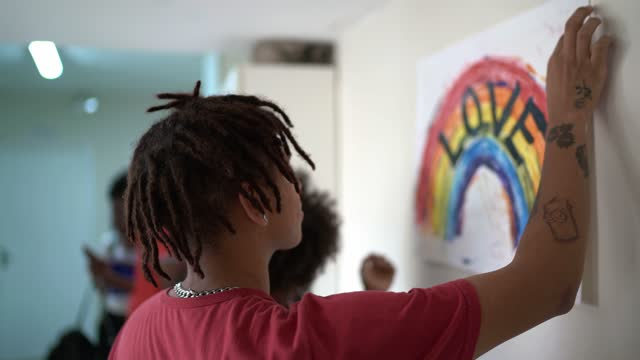 students fixing in the wall a poster about lgbtqi rights - coworker stock videos & royalty-free footage