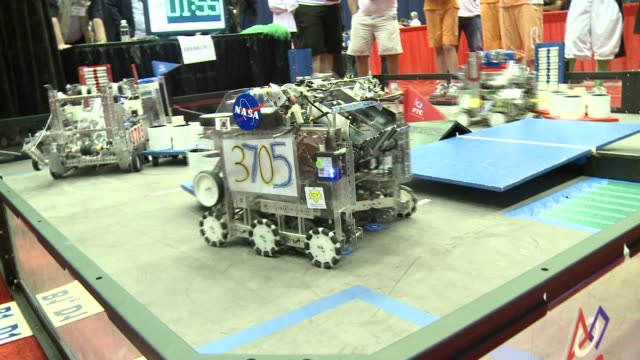 students from around the world pit their robots against each other in the us first championship in st louis robots and teens compete in superbowl of... - erfindung stock-videos und b-roll-filmmaterial