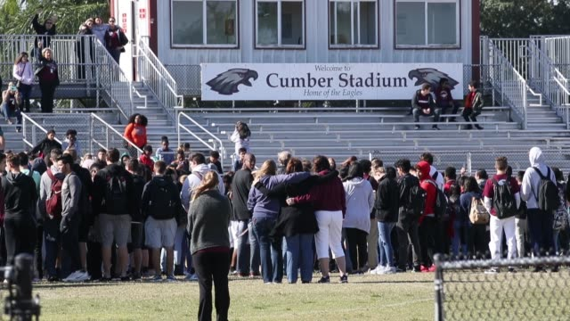 Students from Marjory Stoneman Douglas High School gather on the football field to honor the memories of 17 classmates that were killed during a mass...