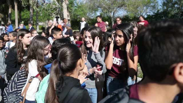 Students from Westglades Middle School arrive at Marjory Stoneman Douglas High School after walking out of their school to honor the memories of 17...