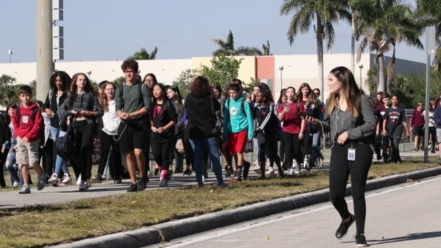 students from westglades middle school arrive at marjory stoneman douglas high school after walking out of their school to honor the memories of 17... - sciopero video stock e b–roll
