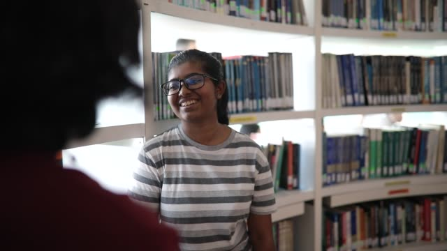 students getting to know one another at library - librarian stock videos & royalty-free footage