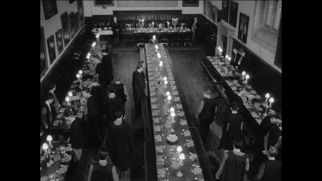 montage students have a meal in a traditional dining hall / oxford, england - oxford university stock videos & royalty-free footage