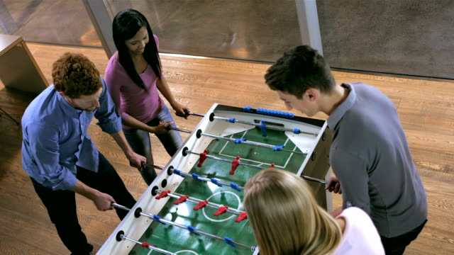HA Students Having Fun Playing Foosball