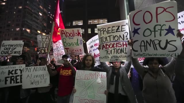 students hold placards as they stage a demonstration at the hunter college which is a part of new york city university to protest ballooning student... - debt stock videos & royalty-free footage
