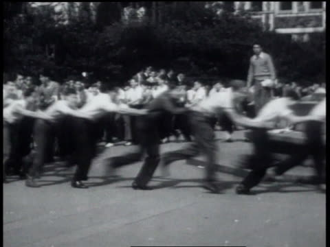 vidéos et rushes de students in a conga line / students running in a line / students brawling - 1931