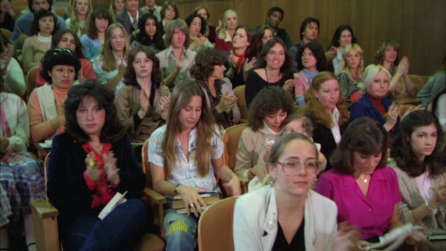 MS Students in audience listen then standing and applauding in College or university lecture hall