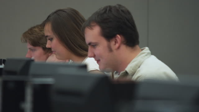 CU SELECTIVE FOCUS Students in college computer lab, Orem, Utah, USA