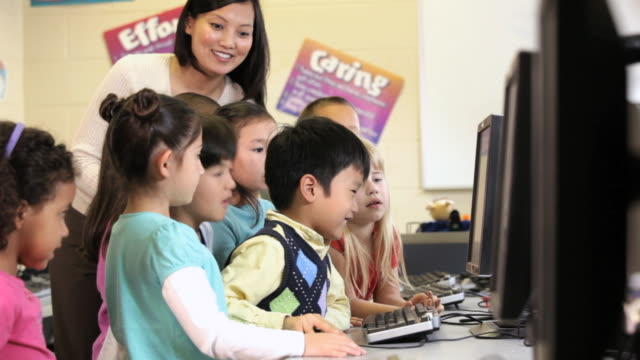 MS TU Students in computer class with teacher / Richmond, Virginia, United States