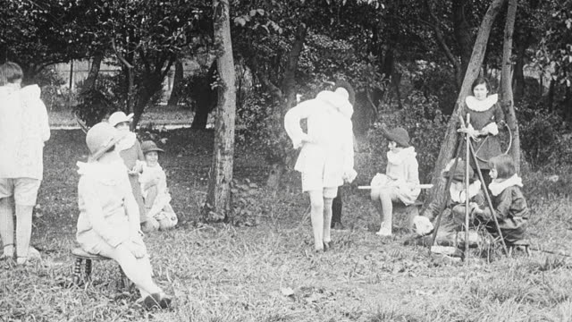 1925 MONTAGE Students in Elizabethan costumes performing outdoor play of scene taking place in the Forest of Arden, possibly Shakespeare's As You Like It / Newcastle upon Tyne, England, United Kingdom