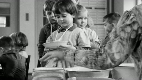 montage students in nursery school cafeteria being served lunch / united kingdom - social grace stock videos & royalty-free footage