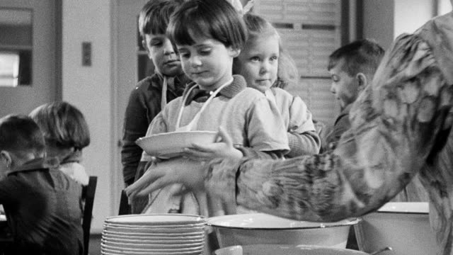 montage students in nursery school cafeteria being served lunch / united kingdom - gutes benehmen stock-videos und b-roll-filmmaterial