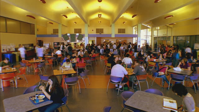 stockvideo's en b-roll-footage met t/l ws students in santa barbara city college cafeteria / california, usa - kantine