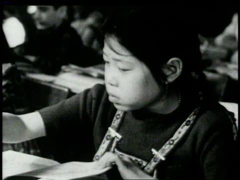 1946 ha students in school reading and writing / new york, new york, united states  - east asian ethnicity stock videos & royalty-free footage