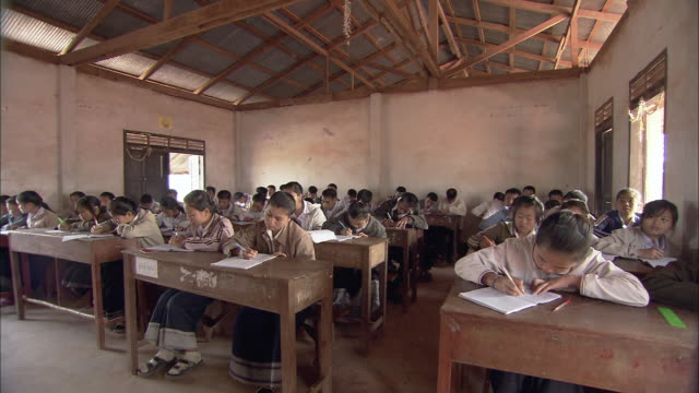 ws students in village classroom, thailand - elementary school stock videos and b-roll footage