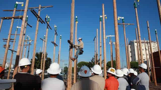 students learn how to hang a single crossarm during training to become electrical linemen during class at los angeles tradetechnical college in los... - technical college stock videos & royalty-free footage