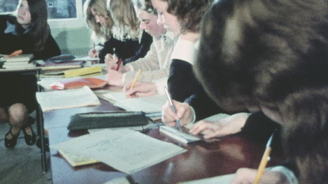1975 MONTAGE Students learning history in the classroom following an outing to Goodwood House / Bognor Regis, England, United Kingdom