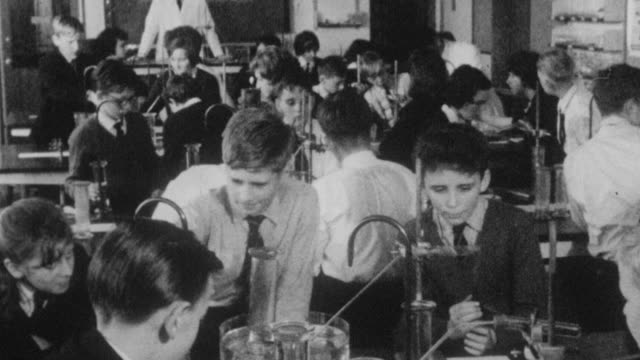 stockvideo's en b-roll-footage met 1962 montage students learning in a science lab at holland park school / kensington, london, england - middelbare scholiere