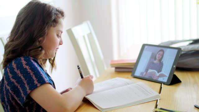 students learning via computer at home - insegnante video stock e b–roll