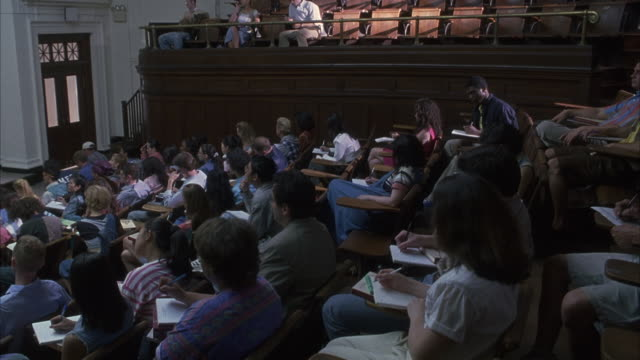 Students listen to a lecturer in a Columbia University lecture hall.