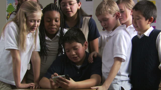 students looking at cell phone - see other clips from this shoot 1148 stock videos & royalty-free footage