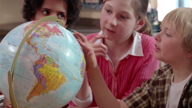 students looking at globe / gorham, maine - physical geography stock videos & royalty-free footage