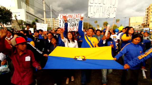 students marched in colonial town of quito against president rafael correa they hold a sign that says children torturer government - ecuadorian ethnicity stock videos & royalty-free footage