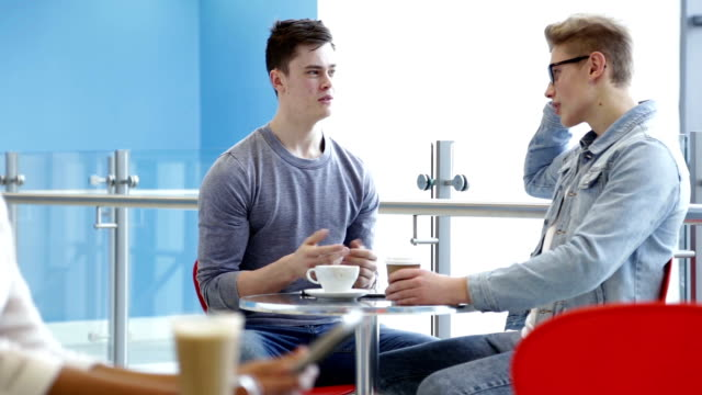 students meet in a cafe for a coffee - coffee drink stock videos & royalty-free footage