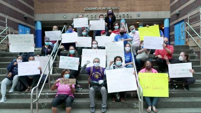 students parents and staff rally in front of edward a reynolds west side high school on the upper west side of manhattan for an informational picket... - reopening stock videos & royalty-free footage