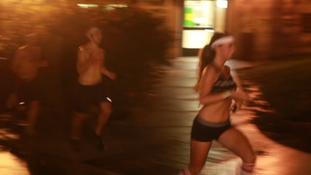 students participate in the nearly naked run organized as a fundraiser during homecoming week at indiana university in bloomington, indiana, october... - ホームカミング点の映像素材/bロール