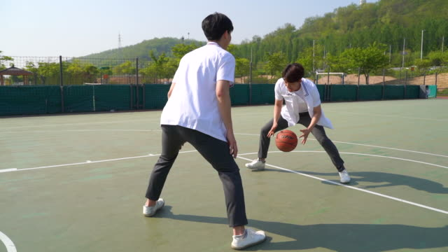 students playing basketball game - shooting baskets stock videos & royalty-free footage