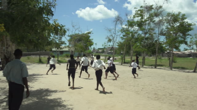 students playing soccer wide - wiese stock videos & royalty-free footage